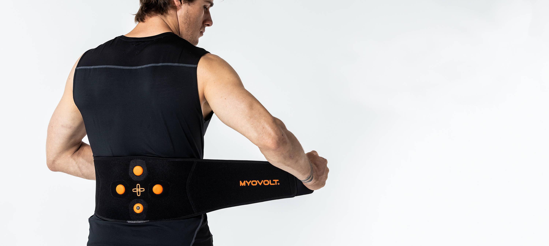 Man putting on Myovolt Back