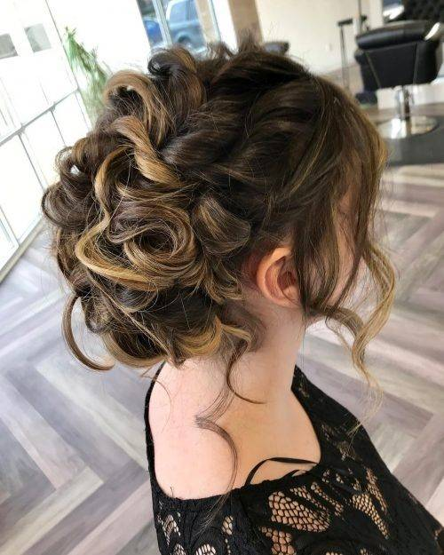 Girl with brown hair updo with loose curls