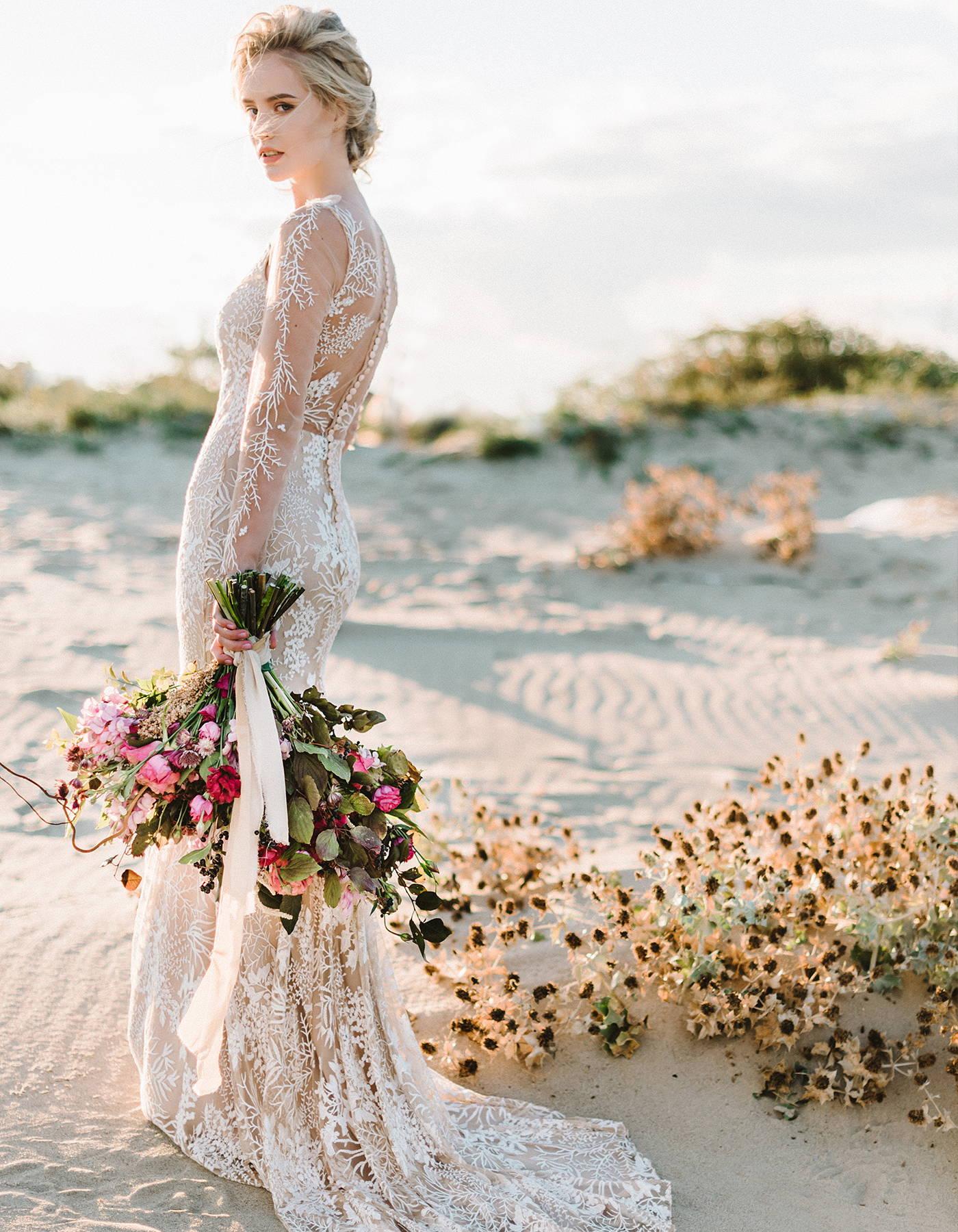 This low back lace mermaid wedding dress has a unique vine floral lace. It is a nude lace wedding dress.