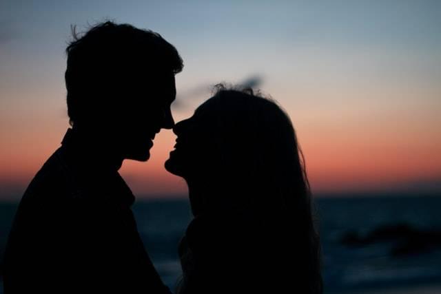 Couple At Night Kissing
