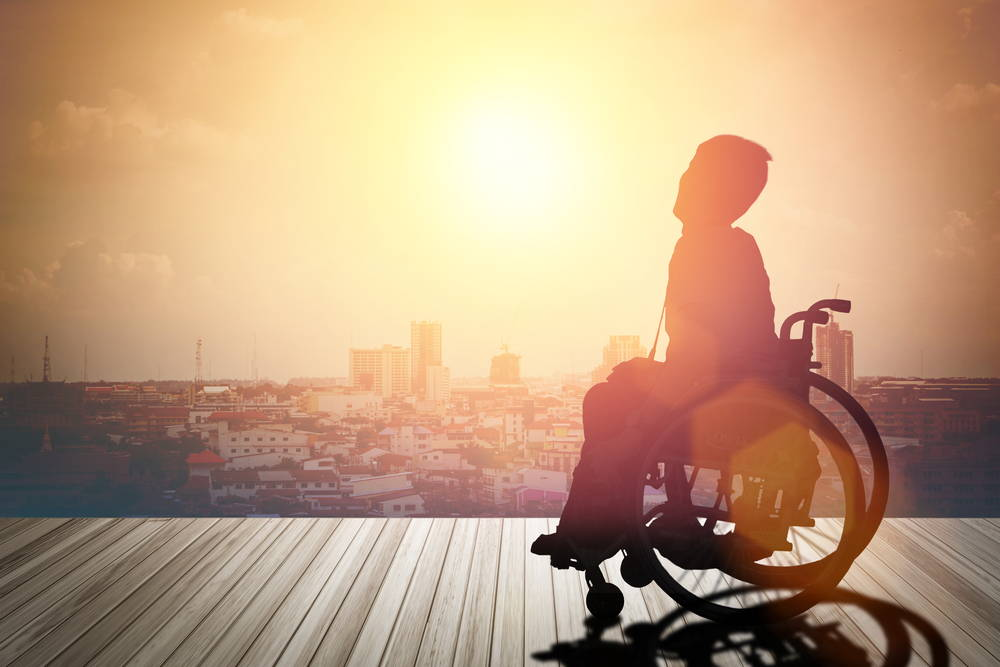 Person In A Wheelchair In The Sunshine