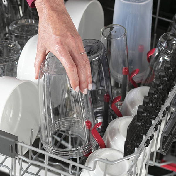 Woman loading top rack of GE Appliances dishwasher