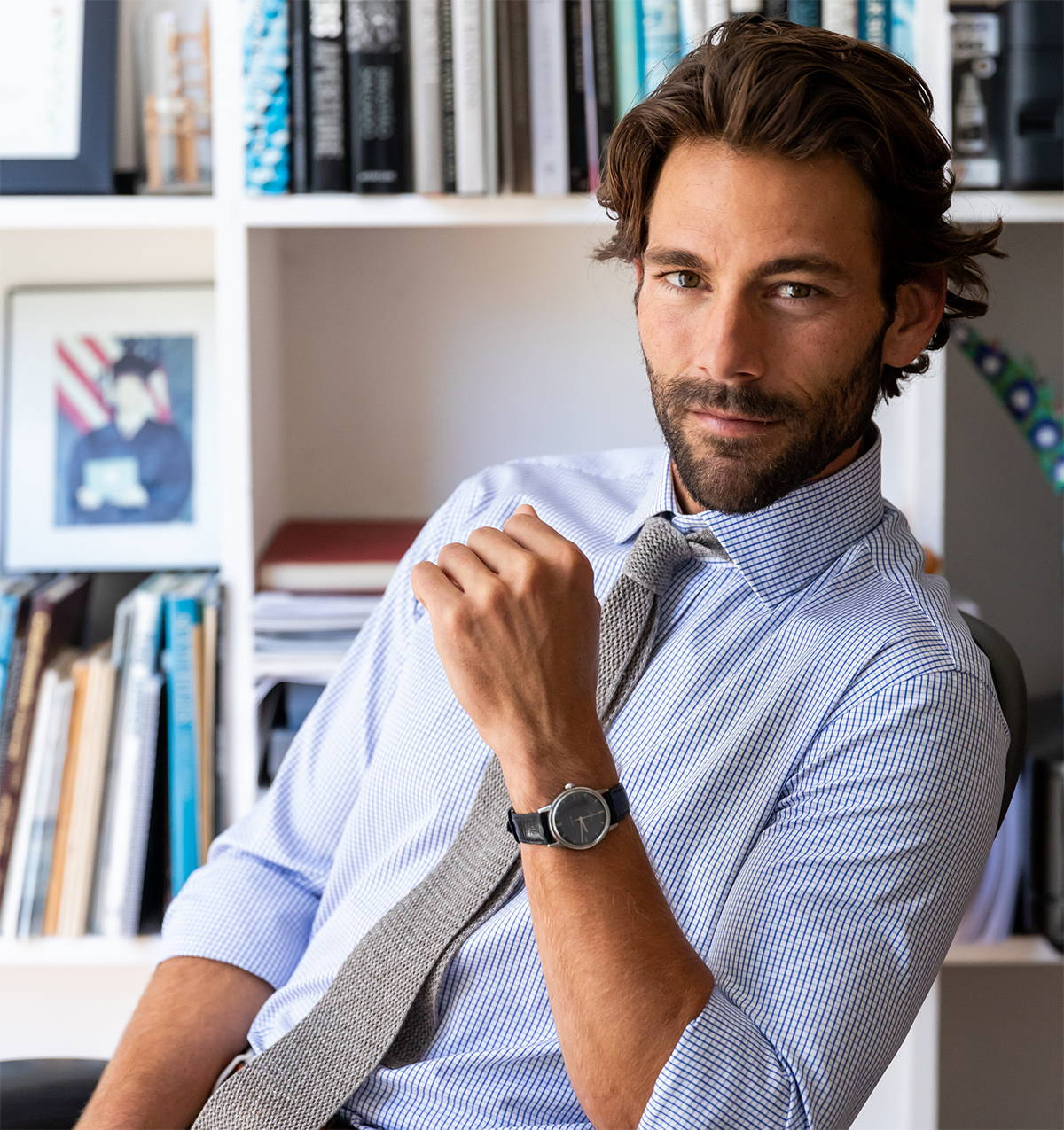 Man sitting in chair wearing Ledbury dress shirt and Ledbury tie
