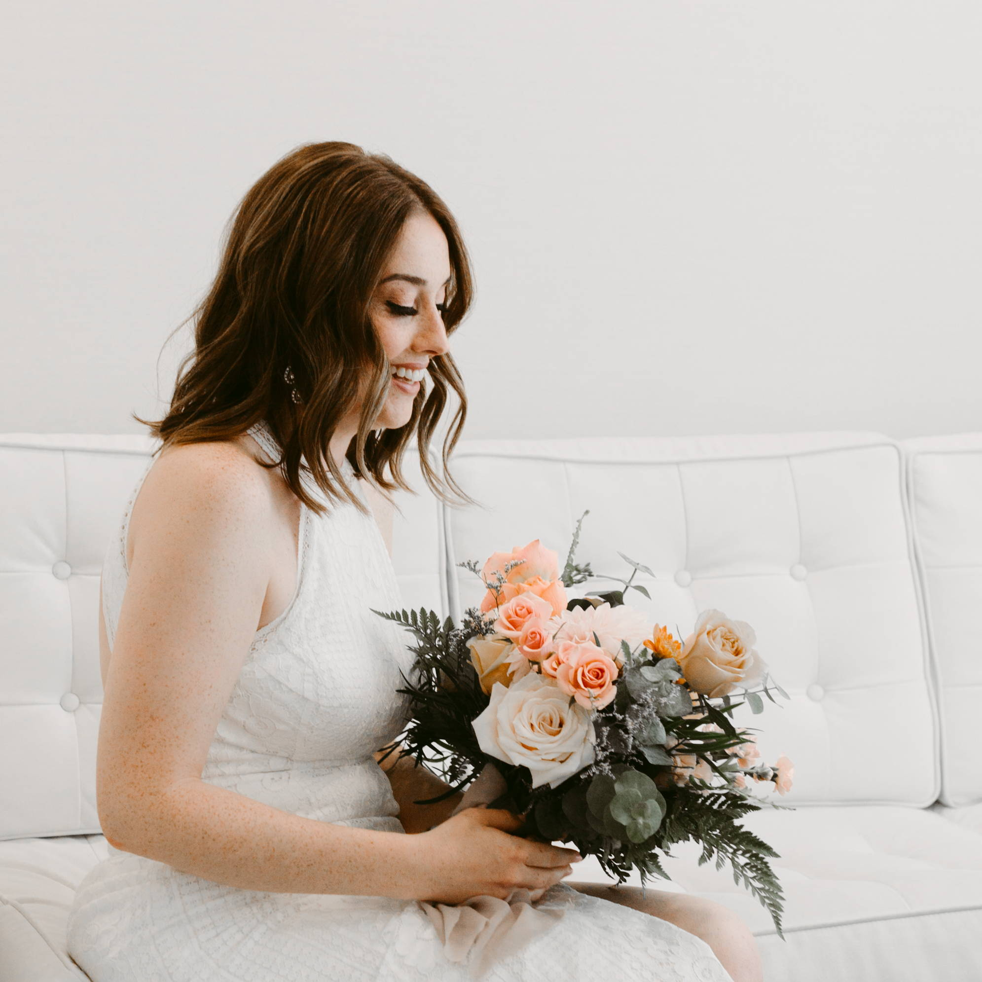 Bride sitting with her bouquet at The Drake Hotel in Toronto