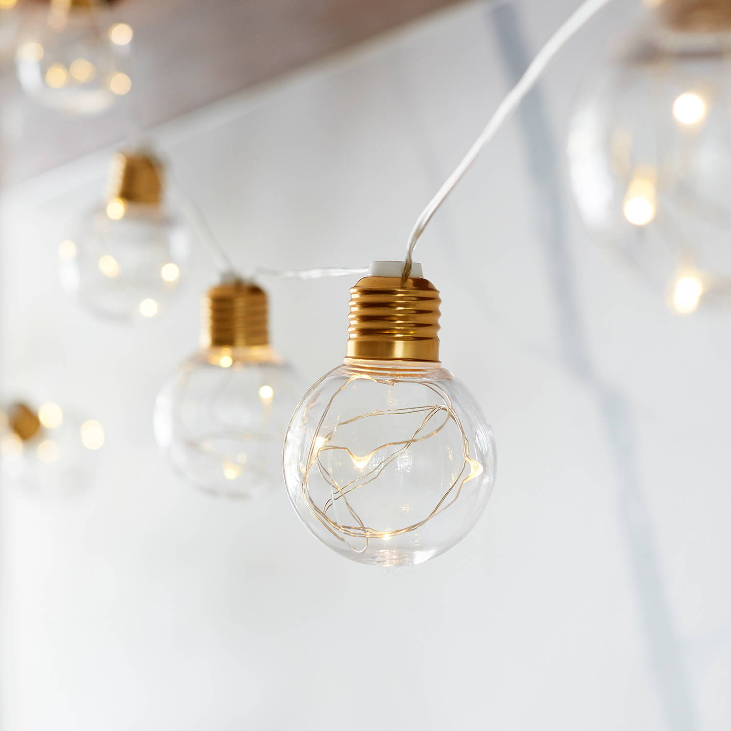 Brass micro battery festoon lights illuminated