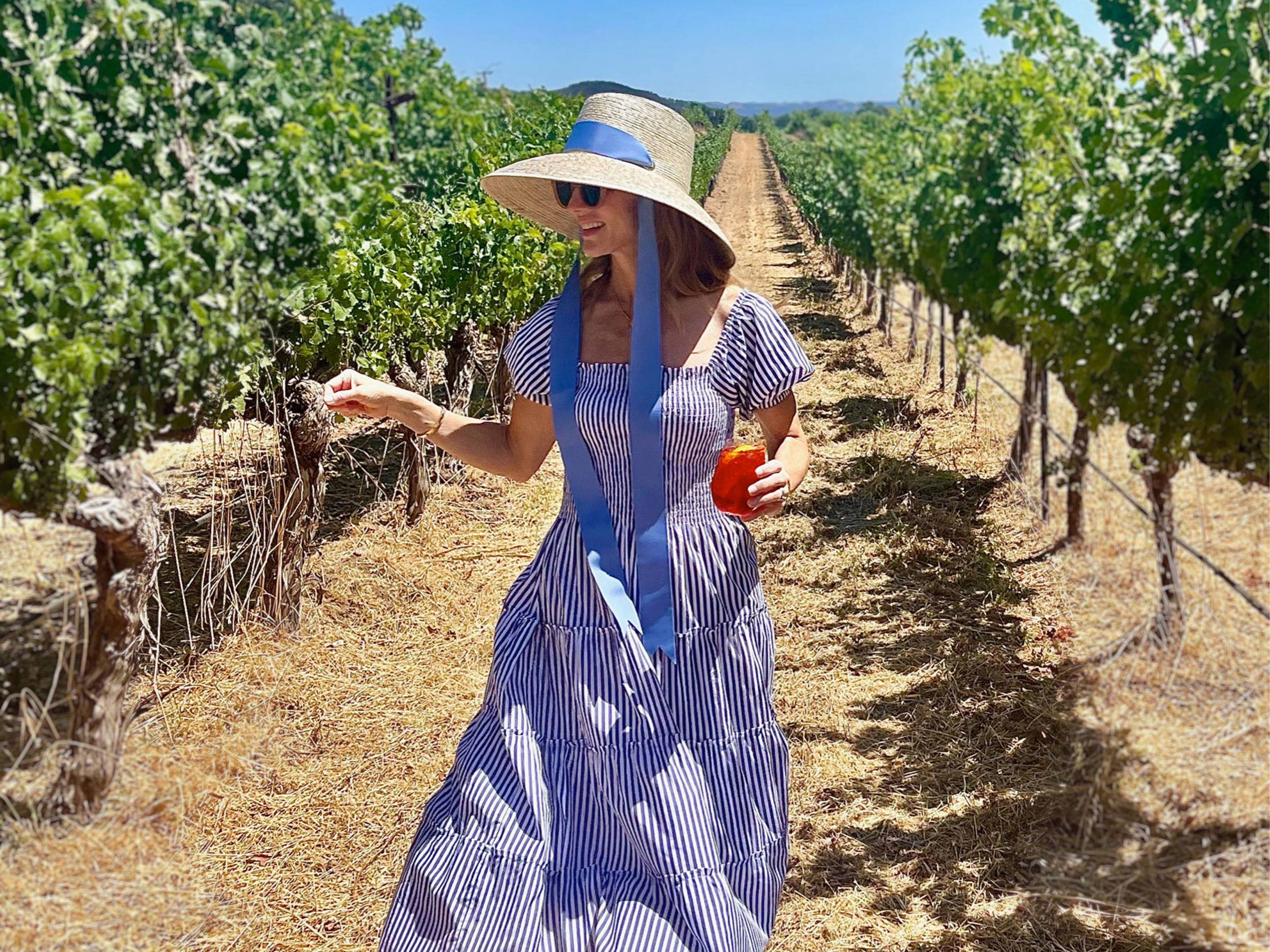 Lady in Vineyards Wearing a Chic Dress