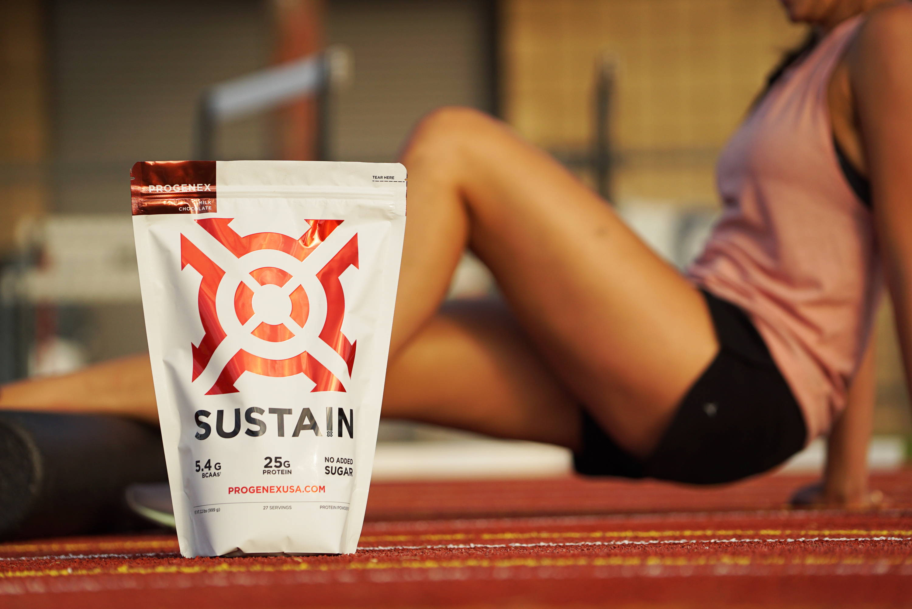 sustain bag with woman rolling out in the background