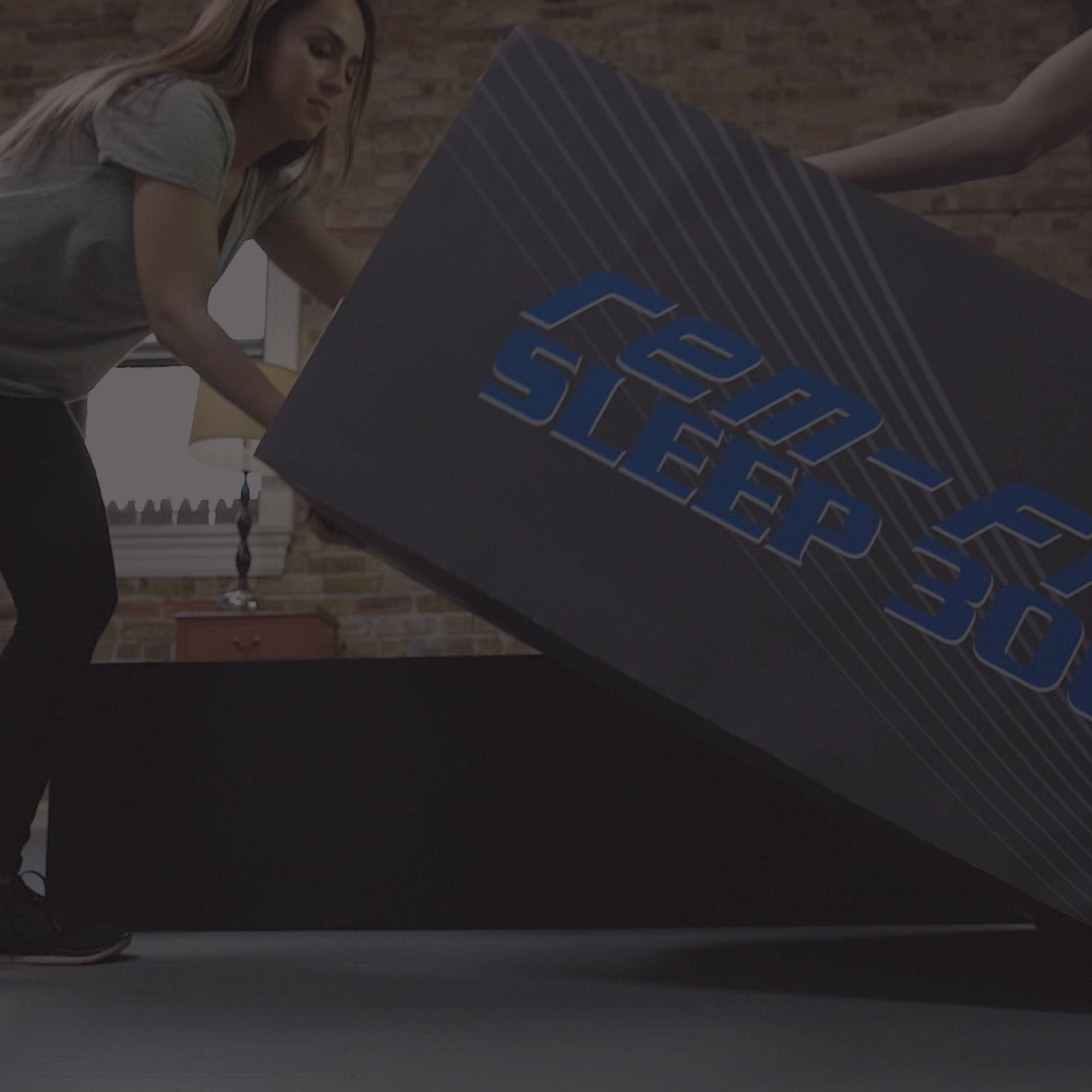 Sleep Product Guides. people moving REM-Fit mattress box