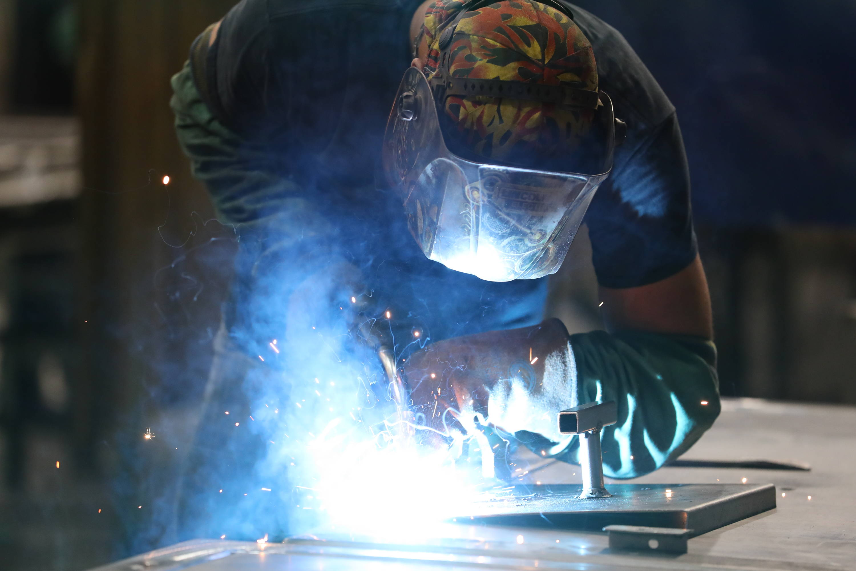 A welder welding a safe door