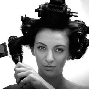 Girl with curlers in