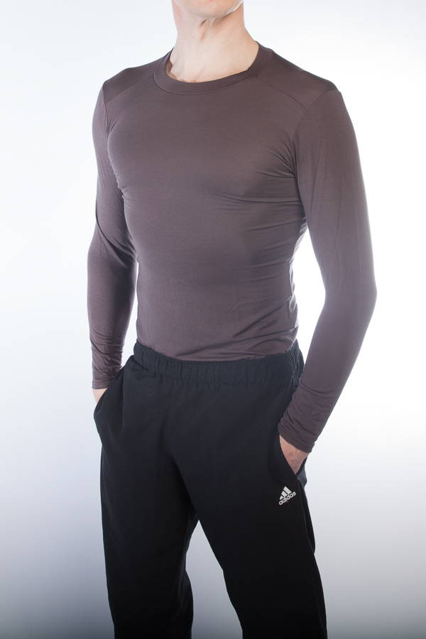 A man in black tracksuit and crew neck sports undershirt in chocolate brown