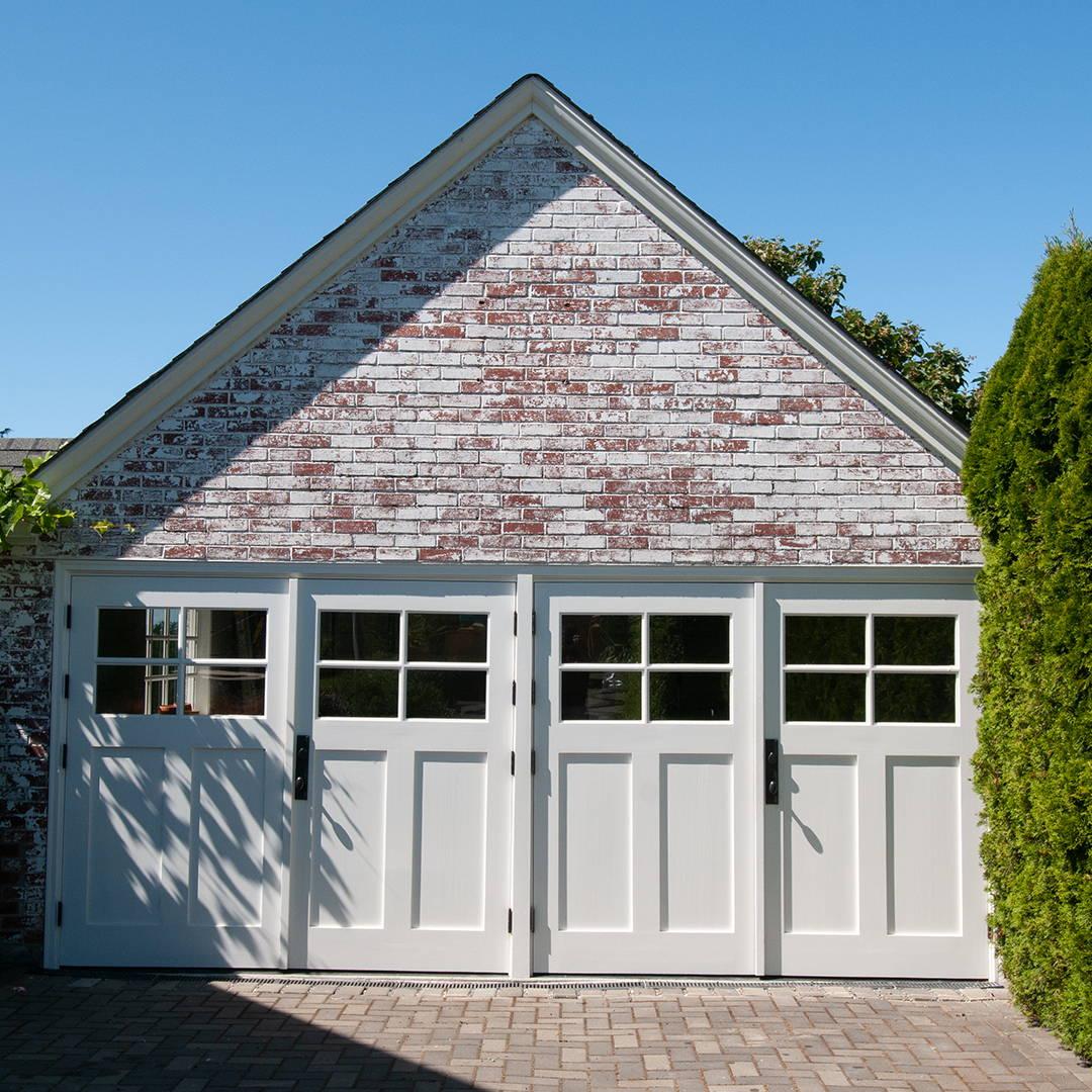white swing open garage door in white