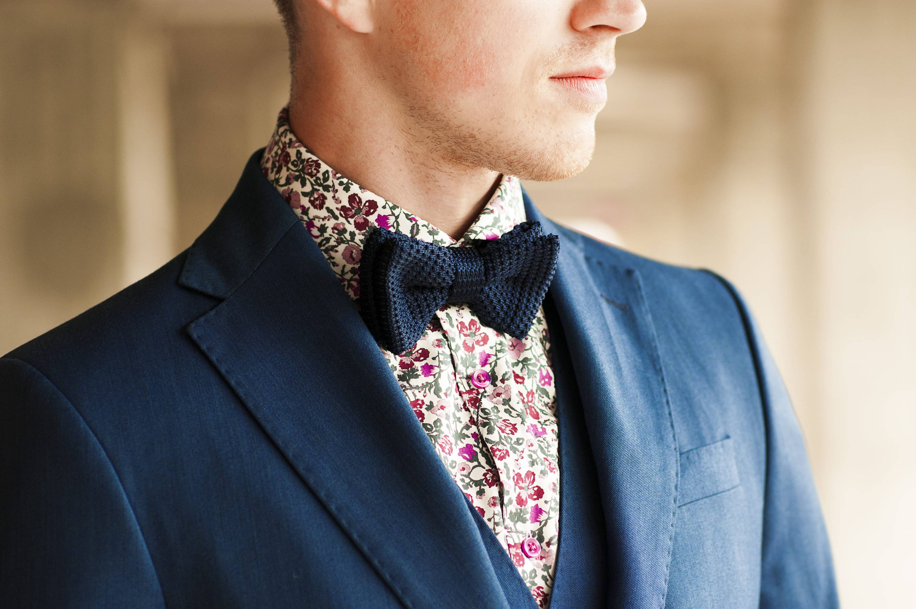 Man wears quirky style floral shirt and textured bow tie