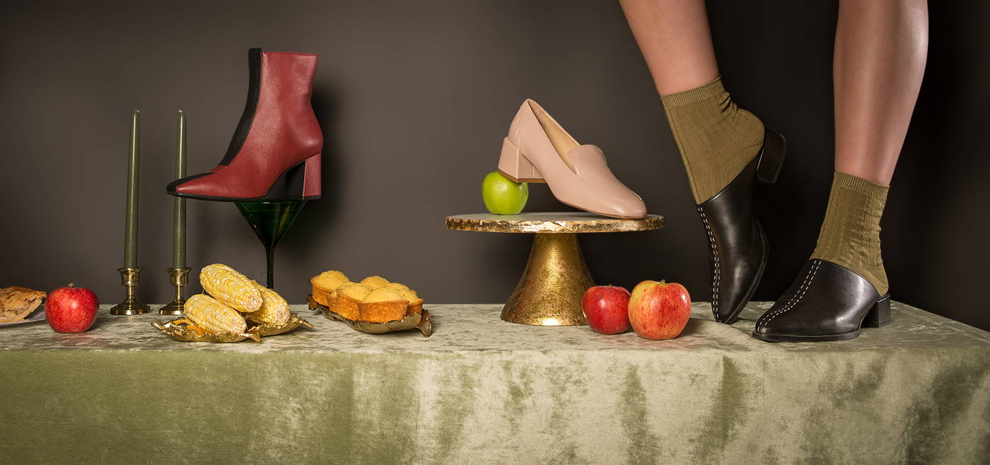Sylven New York sustainable vegan leather boot and loafer styles on a green velvet tablescape