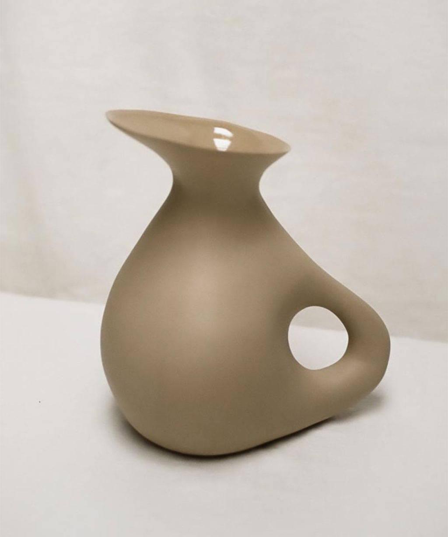 A light brown carafe.