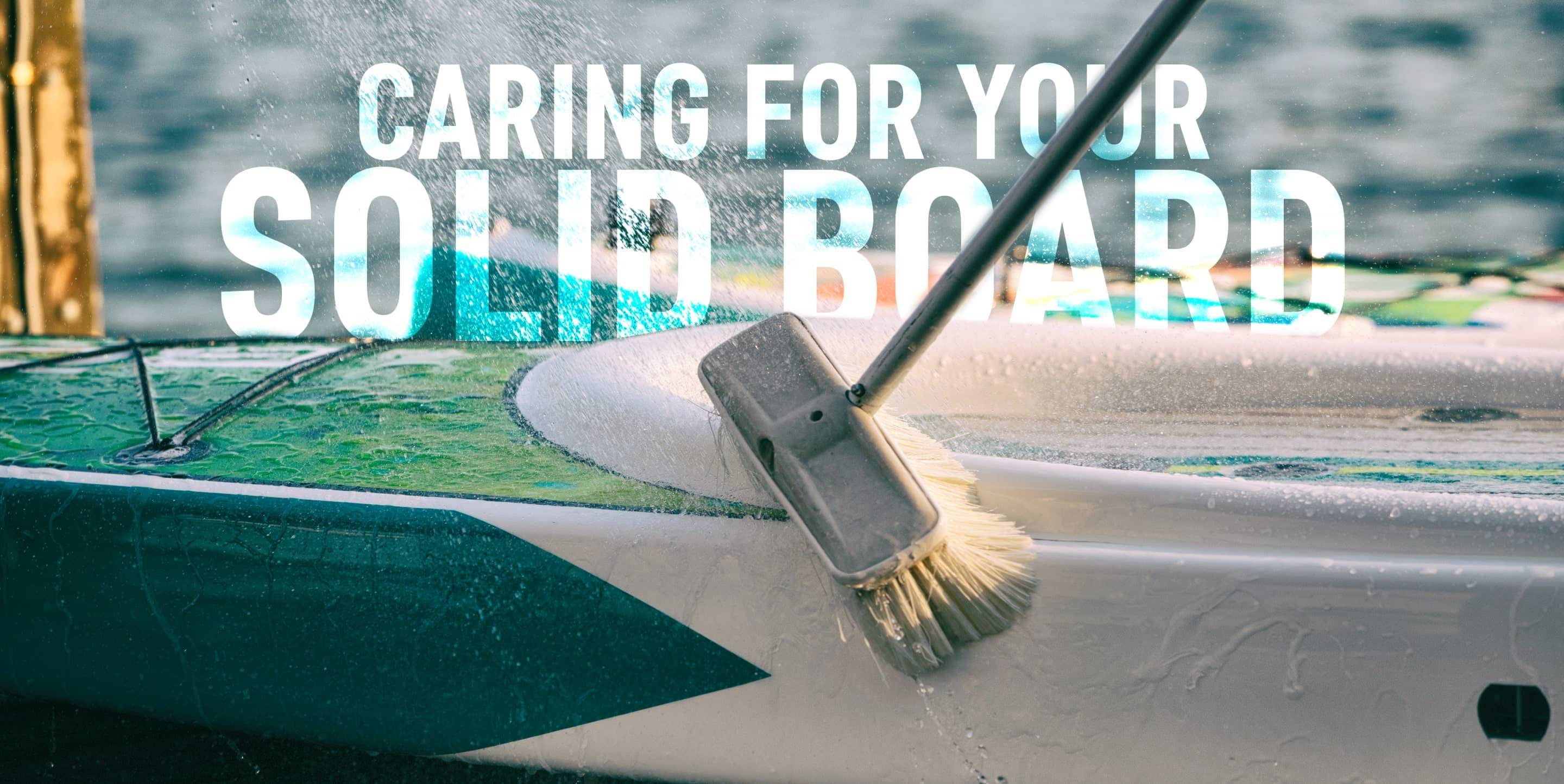 BOTE paddle board being washed with a brush
