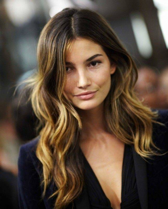 Woman with brown layered ombre hair
