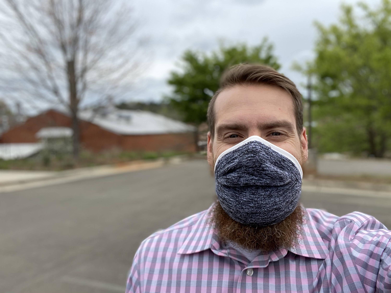 Man wearing mask sticking in his mouth