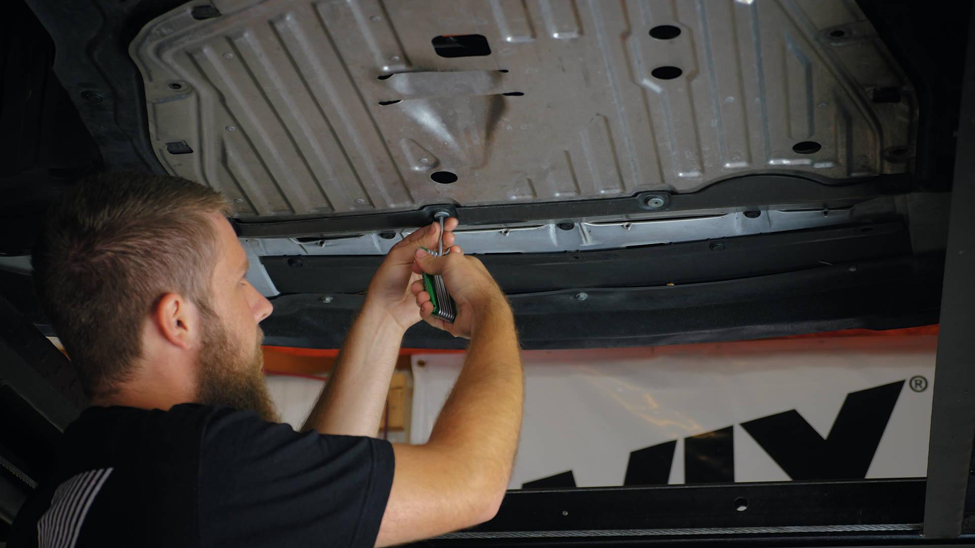 2017 Honda Civic - Using allen wrench on skid plate screws.