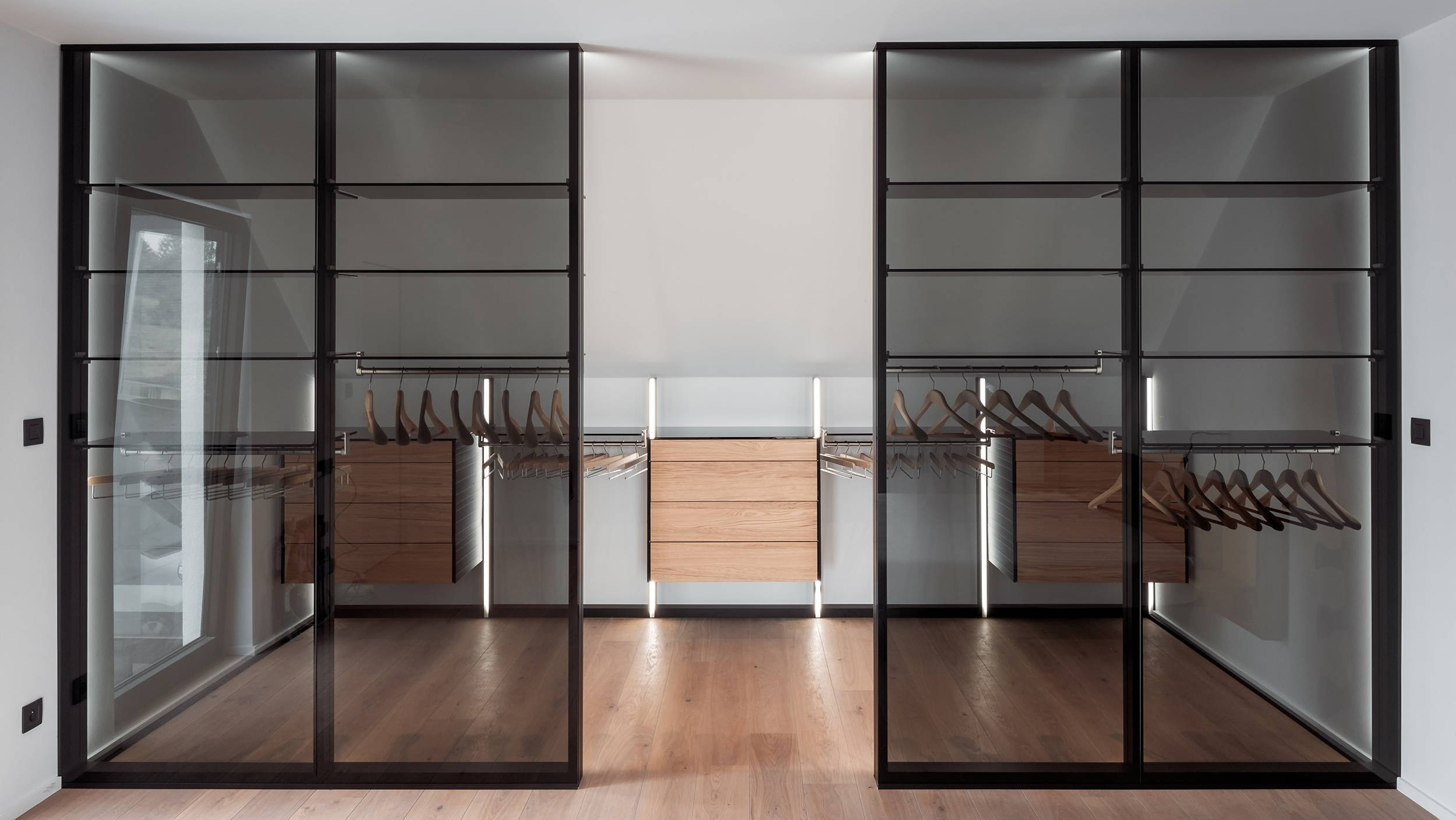 modern walk-in closet with glass