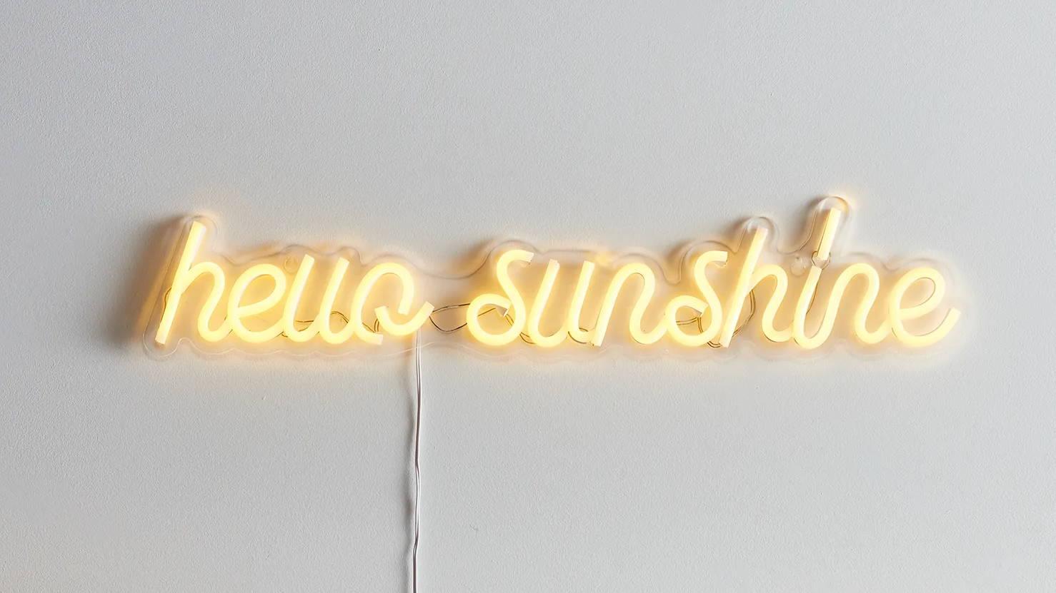 Hello sunshine neon light illuminated on wall