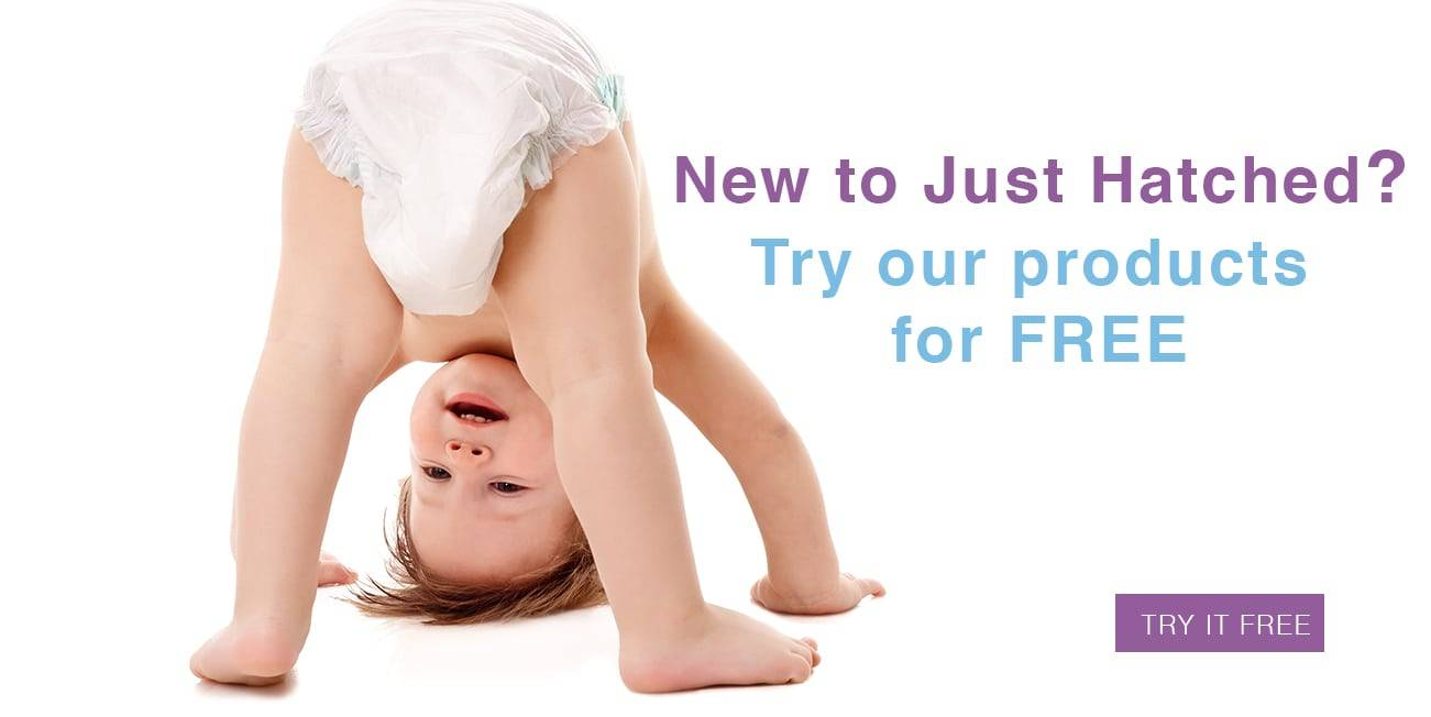 Baby looking through legs, text with, New to just Hatched? Try our products for free. Button try for free.
