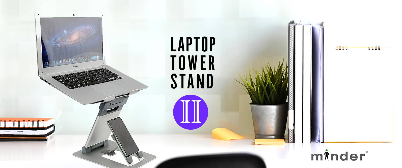 Picture of Laptop Tower II stand on a desk with books