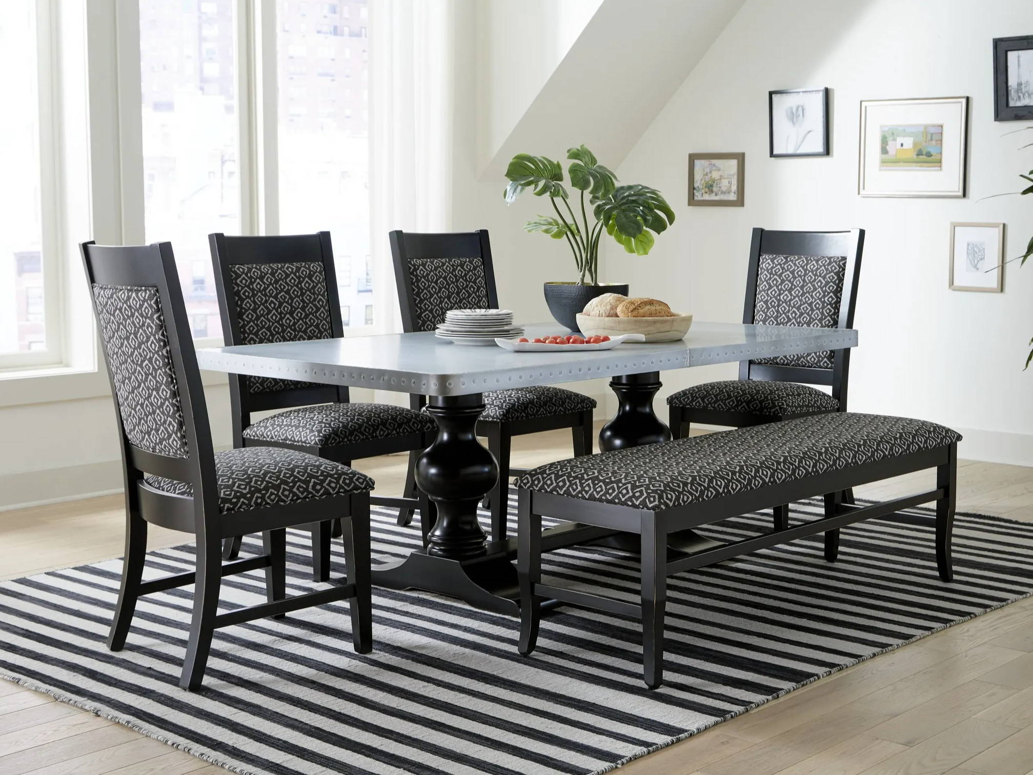 black dining chairs and bench around large dining table
