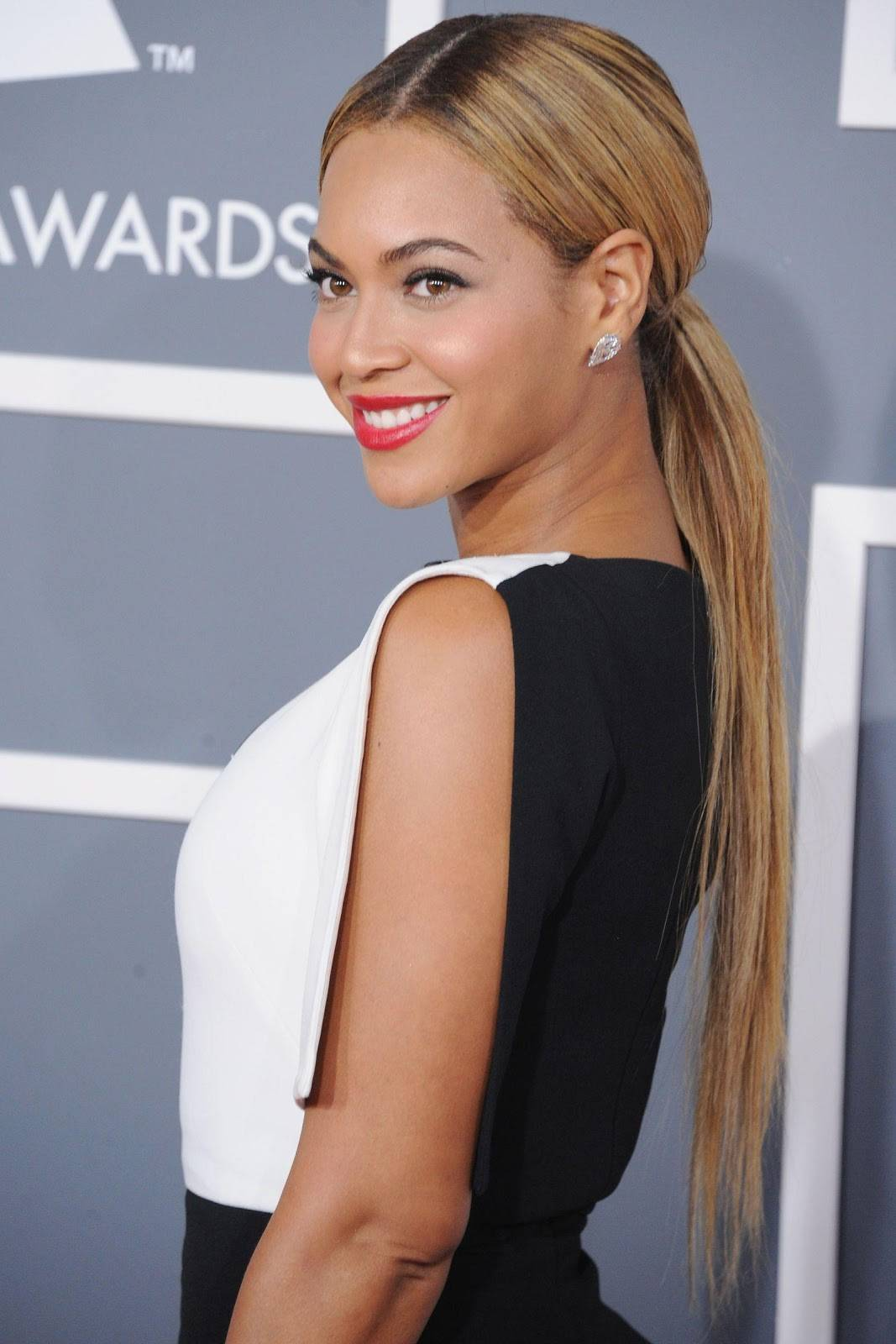 Sleek Ponytail With Center Parting