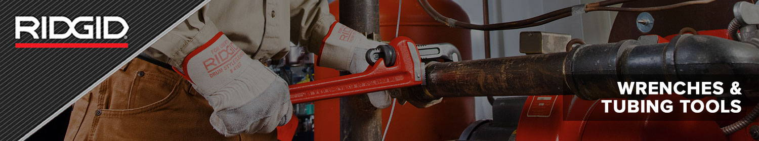 Man Using a Ridgid Pipe Wrench and Ridgid Tool