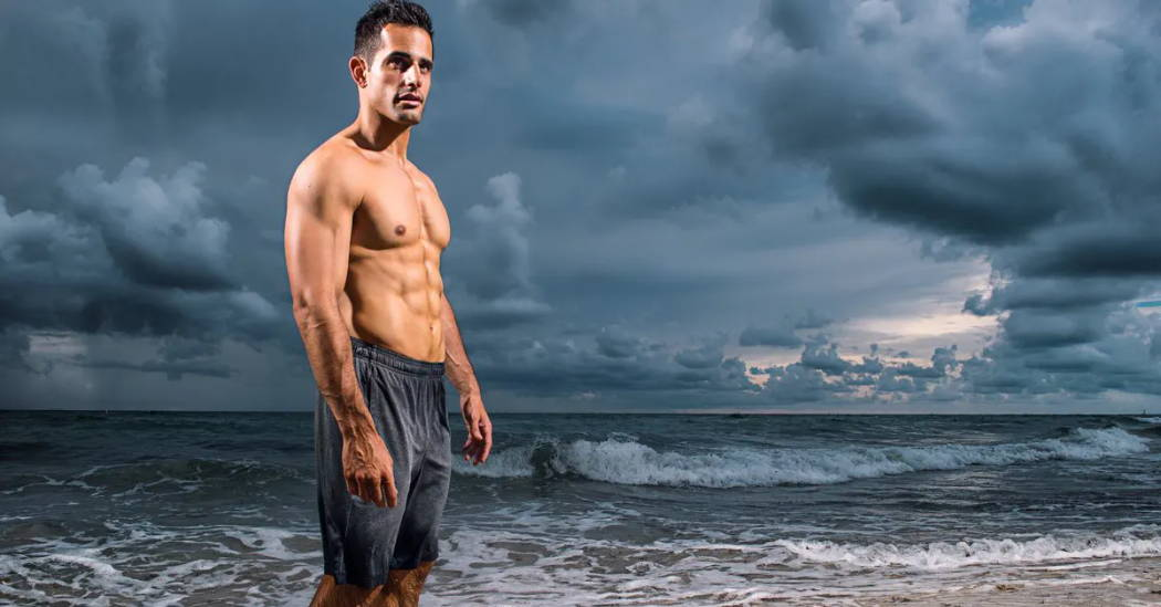 Photo of Chris Van Vliet on a beach