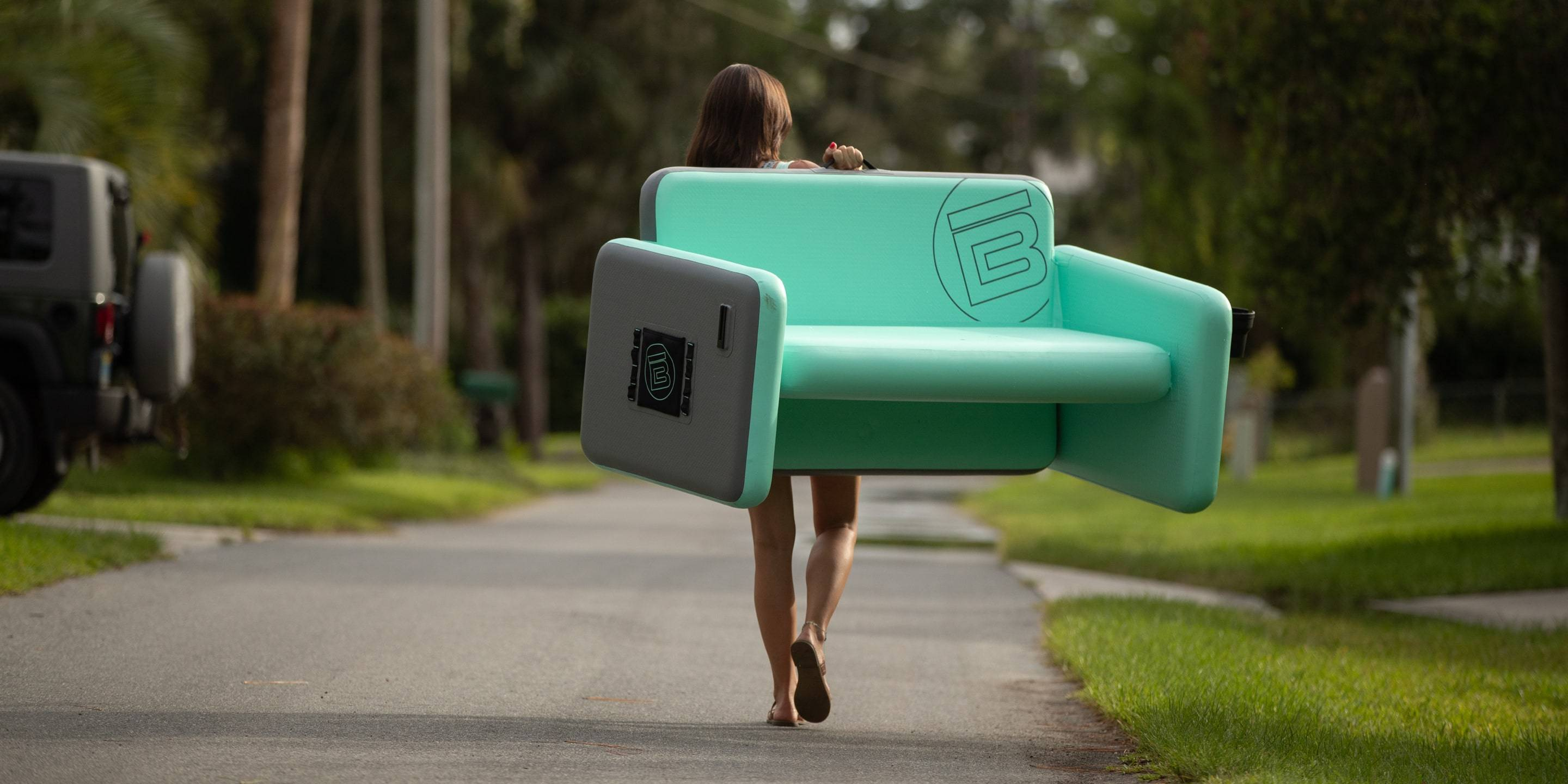 Lady carrying a BOTE aero couch