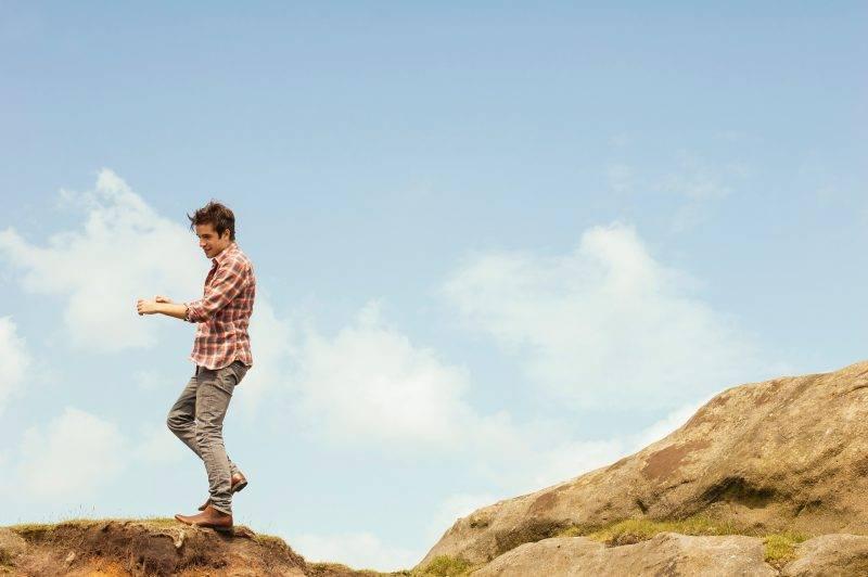 Man Standing On Rocks