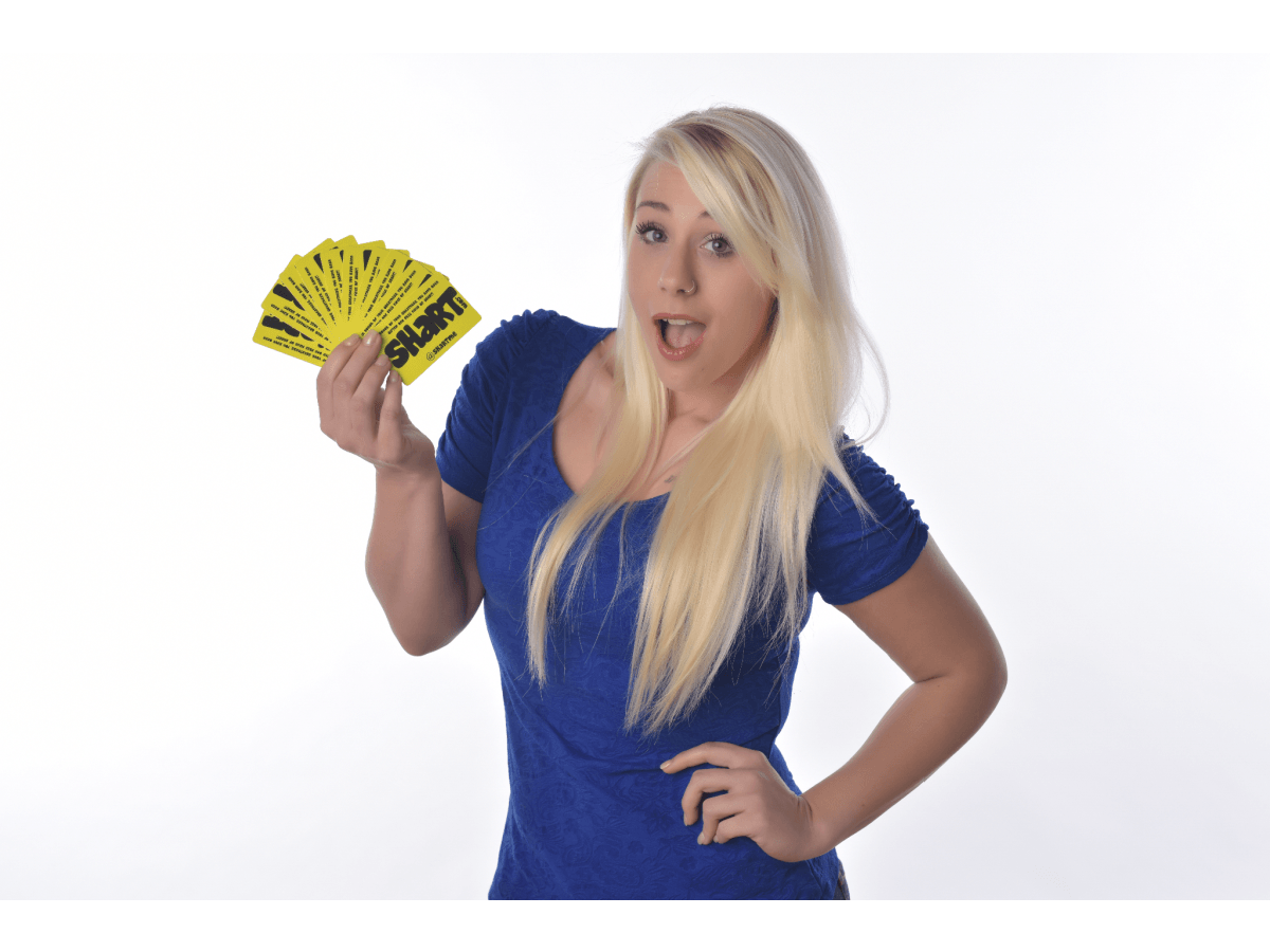 Pretty Blonde Girl Holding a Fanned Bunch of Shart.com Gift Cards