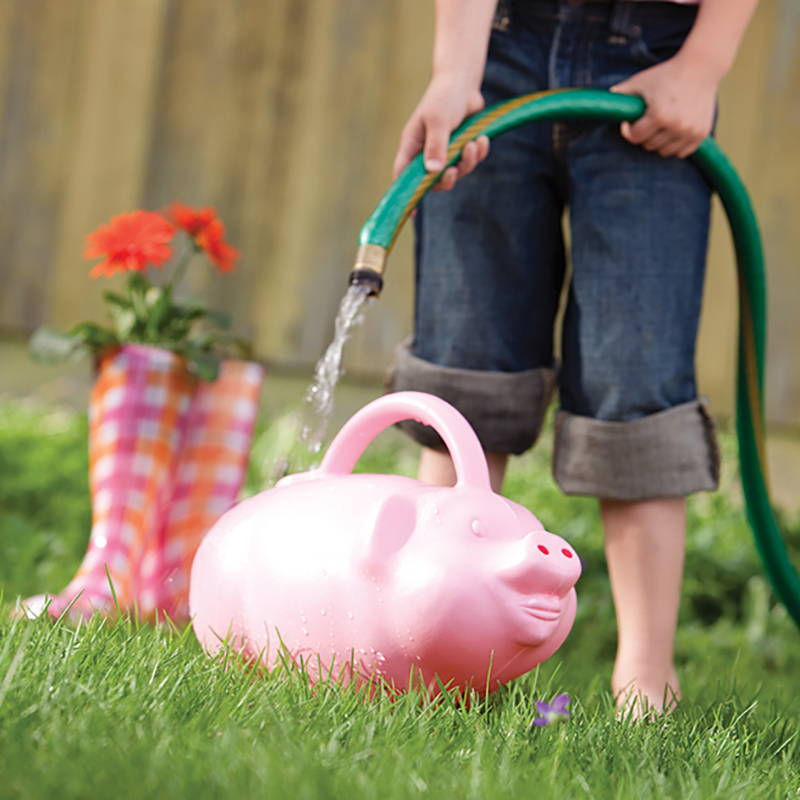Woman filling her pig watering can
