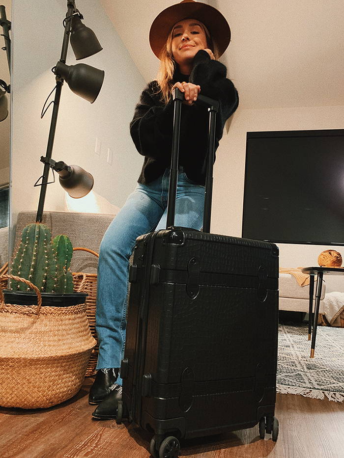 Elena Salsedo with CALPAK Trnk Carry-On Luggage in Black.