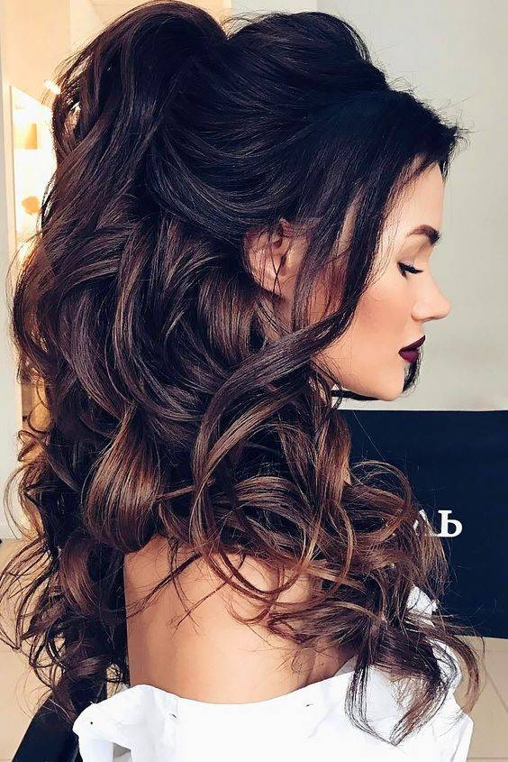Brunette with curly hair half up and half down