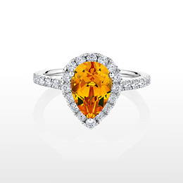 Golden Sapphire pear cut diamond simulant halo ring crafted in white gold