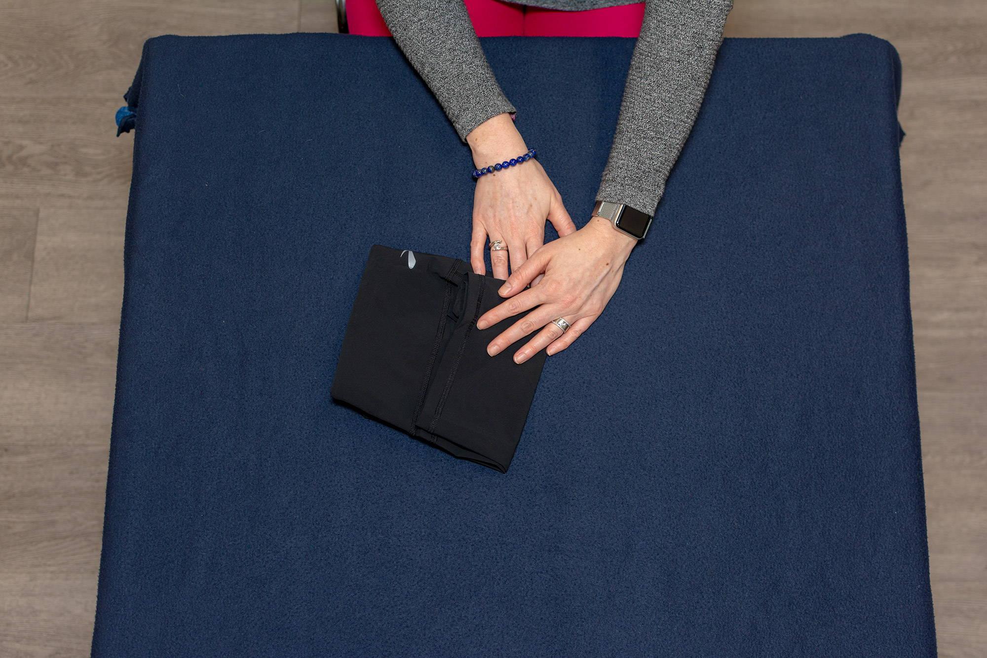 hands folding short shorts