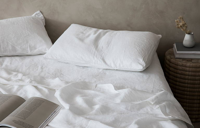 Bed styled with Cultiver white linen bedding