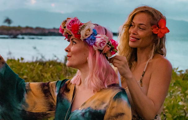 Beachwaver founder Sarah Potempa dons a flower crown with Ocean Dreamer (Pamakani Lehua Pico Purdy) at the Beachwaver Maui Pro Women's Surf Championships