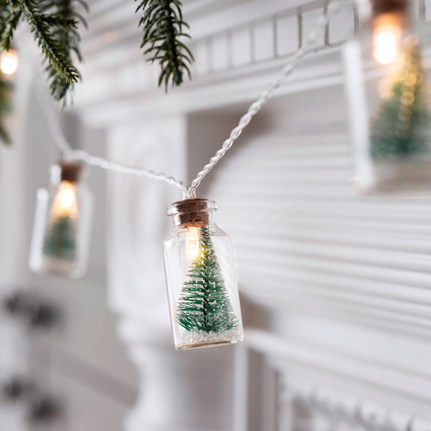 Christmas Tree Bottle Fairy Lights hanging on mantelpiece
