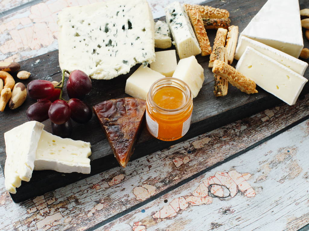 Different types of cheese on a cheese platter