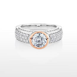 Synergy round brilliant cut diamond simulant ring crafted in sterling silver with 10ct rose gold.