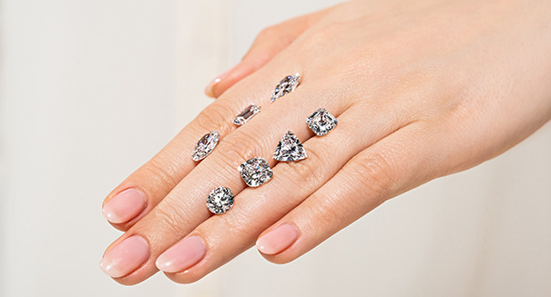 Various diamond shapes resting on a hand