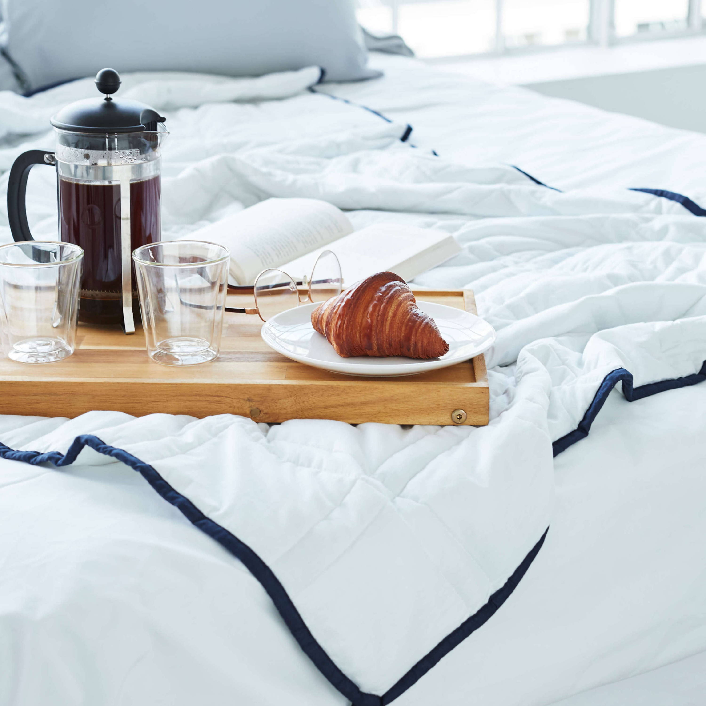 Groundd Weighted Blanket nz out of cover with coffee and croissant