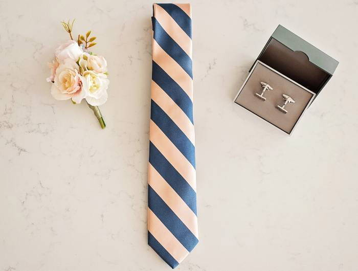 Pink and dusty blue striped wedding tie paired with men's wedding accessories