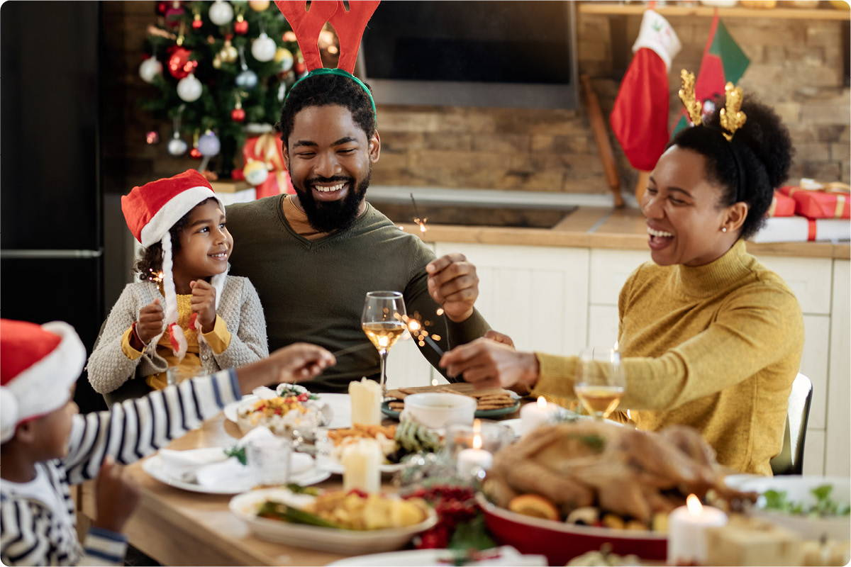 Young family enjoying holiday dinner at home.