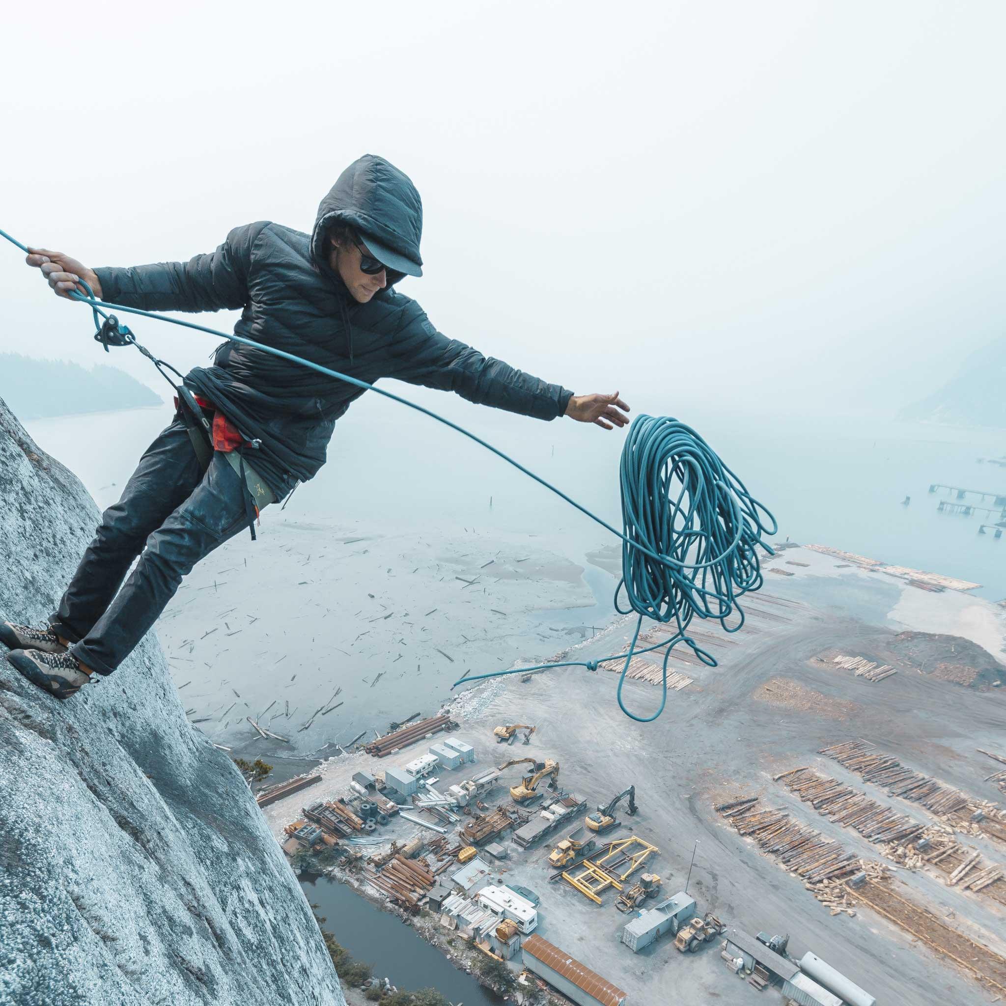 Man rock climbing while wearing Robson Down Hoody