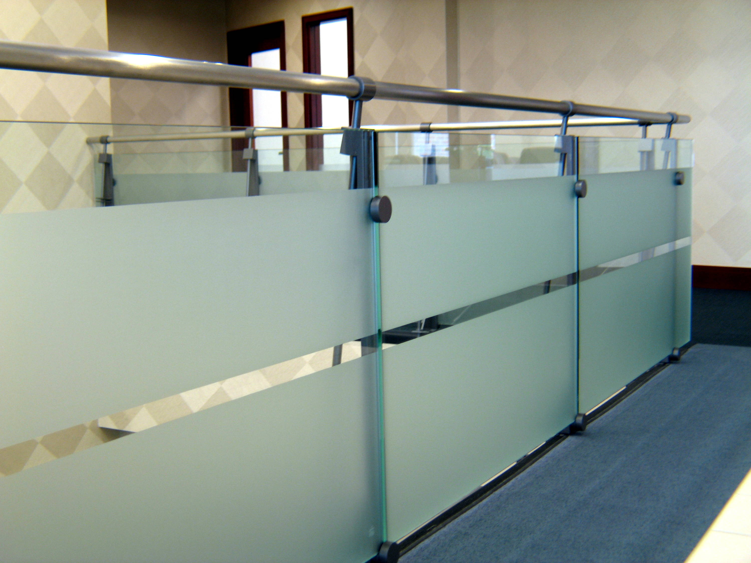 Privacy glass handrails with metal railing